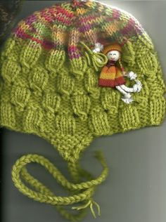 Cute hat for girls with doll attached