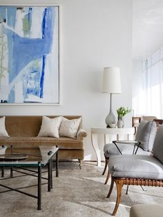 Classic living room design. Clean, simple colors, texture, lines. Tall lamp - giant artwork piece. Light/airy/textural. Mixing brown, grey, white, bronze with pop of color.