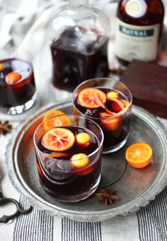 [ Recipe: Mulled Wine ] Made with: red wine (Merlot), brandy, unsweetened apple cider, honey, cinnamon sticks, vanilla bean, cloves, star anise, and chopped citrus (variety). ~ from The Flourishing Foodie