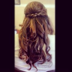 Prom hair 2012. Braided half updo with hurls.