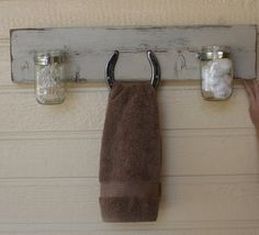 This fun towel rack is distressed with with a horseshoe and two mason jars. We use recycled wood so each one is different, every time! Some