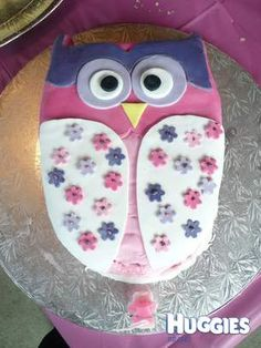 I had made Owl Invites which were the inspiration for this cake.  The cake was chocolate sponge cake which I baked and layered with strawberry mousse. This was then covered with Royal icing which I coloured myself and decorated the cake with, cutting out each shape and finishing with sparkle decorations on the flowers.  It looked great and tasted amazing!