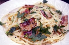 Spaghetti alla carbonara is a classic italian recipe with simple ingredients like pasta, bacon, and a creamy sauce made from eggs.