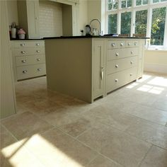 These chipped edge travertine tiles really add a sense of class to this kitchen White Marble Floor, Marble Flooring Design, Kitchen Floor Tile, Tile Inspiration, Prefab Granite, House, Tile Installation, Floor Design, Luxury Kitchen