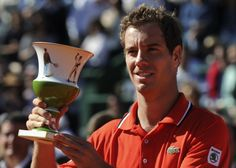 France's Richard Gasquet raises the second-place trophy after losing to Argentina's Juan del Potro on May 6, 2012 during the Estoril Open tennis tournament final at Jamor stadium in Oeiras, on the outskirts of Lisbon.