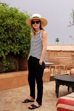 Loving this breezy striped tank paired with relaxed pants, slip on sandals and a wide brimmed had - such a chic summer look!