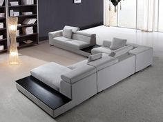 Modern Microfiber Sectional Sofa furniture in Grey - $2650 -- Features: L shape, Side tables with black top, Headrests, 5 seat sofa, Chaise and more. -- URL: http://www.lafurniturestore.com/living-room/modern-sofa/forte-grey-microfiber-modern-sectional.html