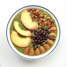 Banana, avocado, kale, spinach, collard greens and coconut water. Topped with peaches, dried mulberries and goji berries, champagne grapes and almonds.