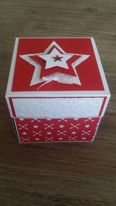 Star themed red and white explosion box for christmas.
