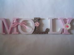 Wooden  letters for nursery in pink, white and brown.. $10.00, via Etsy.