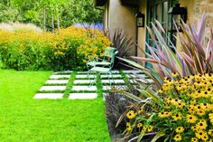"use of pavers as a permeable, ""implied"" patio, and a drought-tolerant combination of Phormium, Rudbeckia, Perovskia, Miscanthus and black mondo grass."
