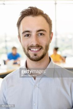 Stock-Foto : portrait of smiling businessman in office