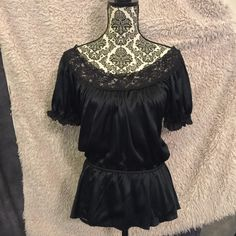 Express Silk and Lace Top Sz Small Express Lace and Silk Top Sz Small. Very good condition. Needs one tiny stitch on lace at neckline in front (pictured). Very pretty and light. Express Tops Blouses
