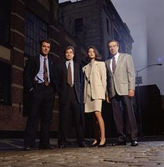 LAW & ORDER -- Season 5 -- Pictured: (l-r) Chris Noth as Detective Mike Logan, Sam Waterston as Executive A.D.A. Jack McCoy, Jill Hennessy as A.D.A. Claire Kincaid, Jerry Orbach as Detective Lennie Briscoe (Photo by: NBCU Photo Bank via AP Images)