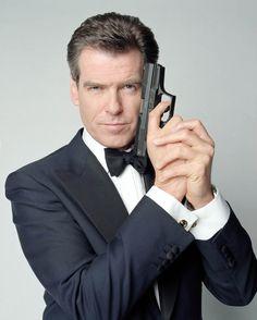 Pierce Brosnan as James Bond in TOMORROW NEVER DIES (1997). Note the Walther P99.