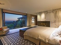 An amazing floor to ceiling window highlights the gorgeous view from Los Angeles to the beach. Cozy up to the marble fireplace and enjoy the sunset. 1157 N. Hillcrest Rd   Beverly Hills