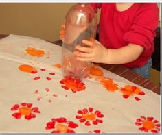 Paint Spring Flowers... (Bottom of plastic bottle for petals, cap for center)! Clever!!