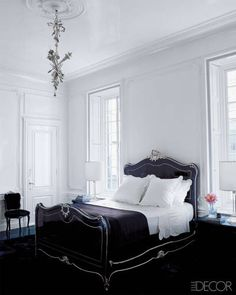 A Manhattan Bedroom: The 19th-century chandelier is ornamented with silver-plate musical instruments.