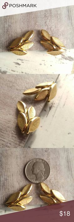 Vintage Crown Trifari leaf earrings gold tone clip Beautiful vintage pair of clip earrings by Crown Trifari - signed on the backs- cluster of leaves shape made of high quality gold tone metal with smooth and textured finish- true vintage made in 1960s or earlier - in very nice condition with light surface wear - from a smoke free home Vintage Jewelry Earrings