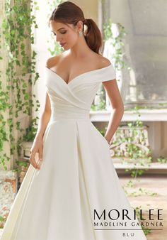 Morilee | Madeline Gardner, Providence Style 5712 | Peau de Soie, Box-Pleated Ballgown with Pockets, with Draped Bodice and Surplus, Off-the-Shoulder Portrait Neckline. Colors Available: White, Ivory