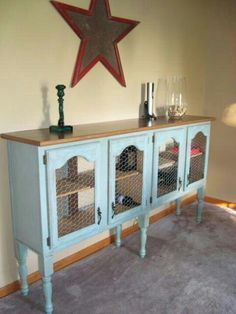 Repurposed kitchen cabinets: i like the basic idea- different color though, shorter legs, chicken wire is a good choice too