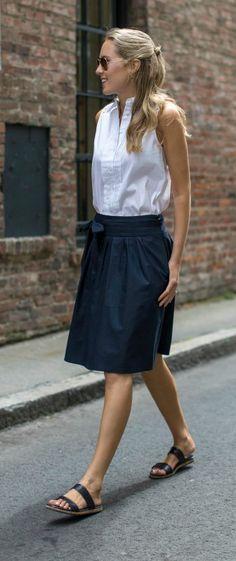 white sleeveless collared shirt with eyelet back shoulders, navy blue tie waist midi skirt, navy two strap slide sandals