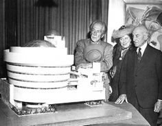 In honor of the Guggenheim's birthday- Architect Frank Lloyd Wright, left, looks over his spiral-shaped building for a proposed Guggenheim Museum with arts patron Solomon R. Guggenheim, right, & artist Baroneness Hilla Rebay (Sept. 20, 1945)