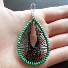 How to make wire earrings decorated with thread via @Guidecentral - Visit www.guidecentr.al for more #DIY #tutorials