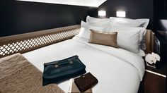 The bedroom with its full-sized double bed by Etihad at The Residence.