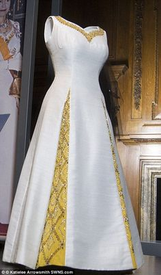 bcd3fa03b0 The Queen wore this elegant ivory dress with embroidered gold detailing to  a state banquet in
