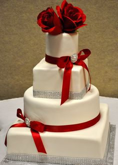 Three tier wedding cake with red flowers and red ribbon #weddingcake