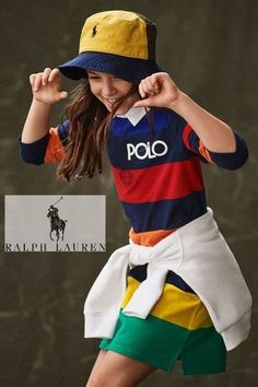 Cool Polo Ralph Lauren Girls Rainbow dress. Fall Streetwear Look. Inspired by Polo Women's collection. Looks perfect with a matching white polo sweatshirt around the waist. Complete the look with a pair of white sneakers and a yellow polo logo baseball hat. Shop girls streetwear clothes @ Childrensalon (affiliate). #polo #ralphlauren #girlsdress #girlstreetwear #childrensalon #dashinfashion Girls Designer Clothes, Girls Special Occasion Dresses, Polo Ralph Lauren Kids, Polo Logo, Striped Polo Shirt, Hat Shop, Long Sleeve Polo, Baseball Hat, White Sneakers