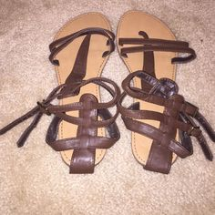 Brown sandals Brown sandals. Worn a few times. The top of one of the sandals is ripped a little Shoes Sandals