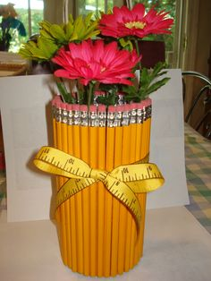 Teacher gift.  Pencil vase with flower pens.    Directions at: http://www.obseussed.com/2011/08/pencil-vase-teacher-thank-you-gift.html?