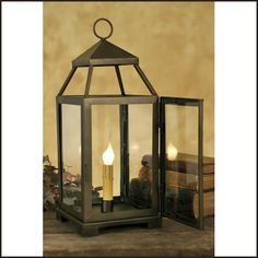 """Bronze Lancaster Lantern Medium by Colonial Tin Works. $51.95. Bronze Lancaster Lantern Medium This Lancaster Lantern measures 9"""" wide and 18"""" tall. This bronze finish is spectacular. It is a dark gold finish with small metallic flecks. Has a door in the back to allow light bulb to be replaced. Light bulbs are not included (click here)."""