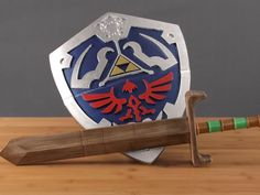 https://www.youtube.com/watch?v=BxlorGcJpZE   In this project, we're 3d printing Link's Hylian Shield from Zelda.   Read the full guide on learn.adafruit.com   It's over 450mm long and features a built-in handle. It prints in just 2 parts. The bottom part is printed upside down so the support material is easy to remove by hand.   You can download the design and customize the parts to fit your 3D printer.