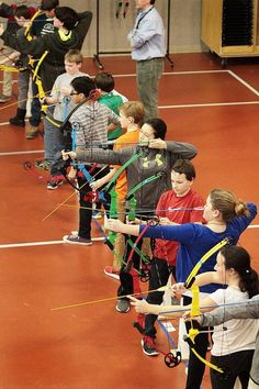 Students take part in an archery competition at Glen Urquhart School in Beverly.