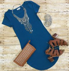FUN IN THE SUN TUNIC DRESS: TEAL  $22.00  The Fun in the Sun Tunic Dress in Teal is comfy, fitted, and oh so fabulous! A great basic that can be dressed up or down!     Sizing:  Small: 0-3 Medium: 5-7 Large: 9-11  True to Size with a Stretchy, Fitted Look. Size Up if you don't care for super fitted dresses :)  *This is still a fitted dress. It's not a loose/flowy cut*  #funinthesun #tunic #dress #yellow #comfy #fitted #fabulous