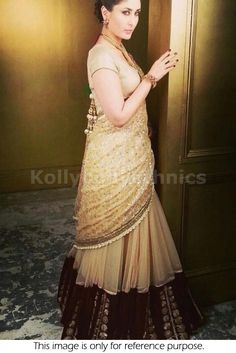 Bollywood Actress Kareena kapoor net lehenga in gold and beige color
