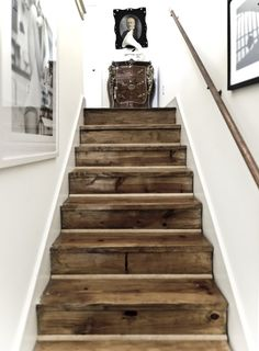 Inspiration to go white GORGEOUS reclaimed barn wood stairs.I love the look of stark white agains a knotted, brown wood in a distressed nature. Post on all different ways to use reclaimed barn wood or recycled wood in your home decor.