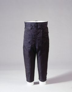 Mens breeches from the German national museum, in silk with a cotton lining and silk covered wooden buttons.
