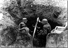 Waffen SS mortar crew firing from prepared position on the advancing Russians, Siege of Budapest, 1944-45. The siege lasted from Oct 44 to mid Feb 45. German losses were crippling; five army and SS divisions were wiped out. The 1st Hungarian Corps was also wiped out. The Red Army suffered an estimated 150,000 KIAs and wounded in action.