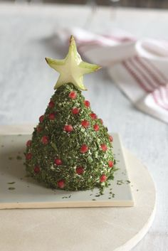 Christmas Tree Cheese Ball (I actually couldn't find the recipe on the website but like how they decorated the tree)