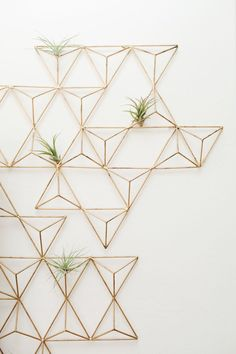 brass geometric wall