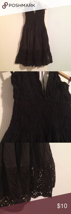 Black Cotton Sun Dress NWOT No brand 100% cotton black halter top sundress with a full skirt, lace bottom. I purchased this in Mexico years ago but it's never been worn. New without tags. Dresses