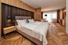 Guest room at the Hotel Genziana in Ortisei, Italy designed by Rudolph Perathoner