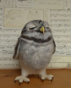 Needle felted owl baby by Helen Priem...it looks so real!
