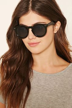 A pair of sunglasses with a round frame. #accessorize