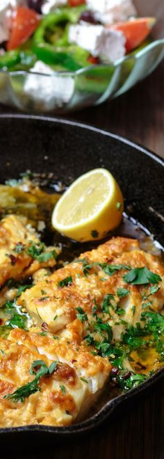 Greek-Style Baked Cod Recipe with Lemon and Garlic | The Mediterranean Dish. Easy, weeknight dinner! Baked cod, spiced Greek-style and baked with fresh lemon juice, olive oil and garlic. Takes 15 minutes or less in your oven! #greekfood #codrecipe #medite