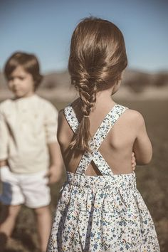 braided hair and criss cross flower sundress